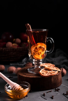 Hot tea with cinnamon and honey