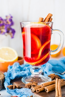 Hot tea with lemon and cinnamon in a glass. winter warming drink
