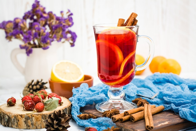 Hot tea with lemon and cinnamon in a glass
