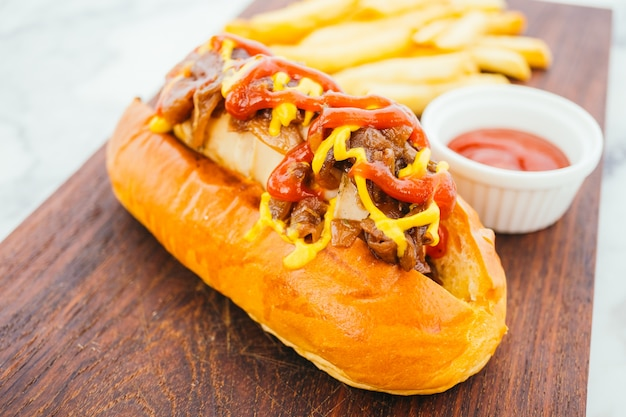 Hotdog with french fries and tomato sauce