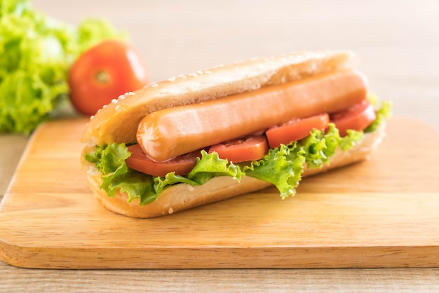 Hotdog with sausage and tomato