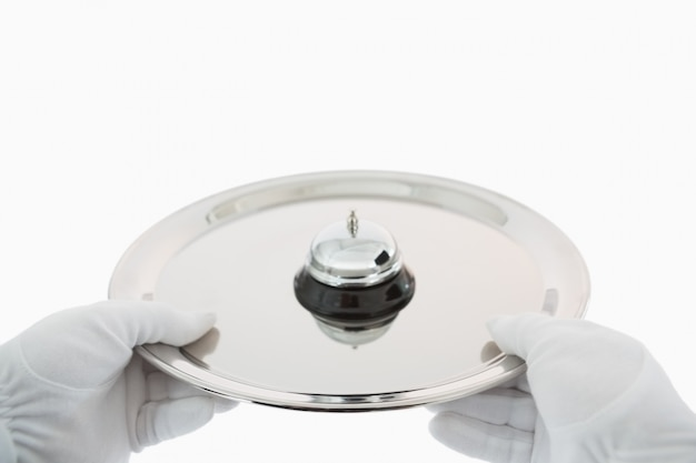 Hotel bell on a silver tray