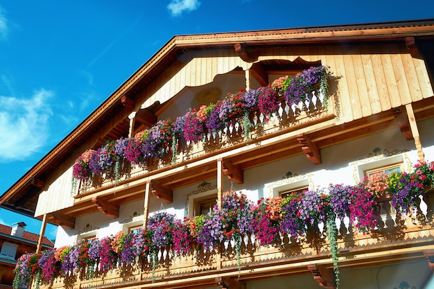 Hotel building with colorful flowers on balconies