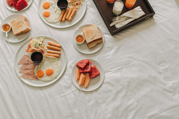 Hotel complimentary breakfast served on white bed
