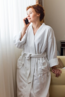 Hotel guest speaking by phone in room