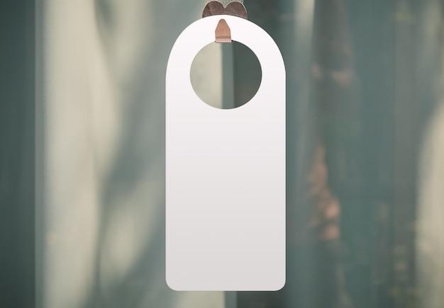 Hotel hanger sign, door knob. do not disturb. please make up the room