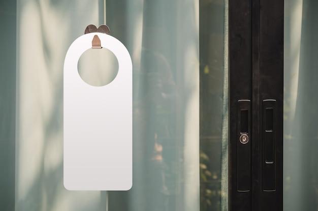 Hotel hanger sign on door knob