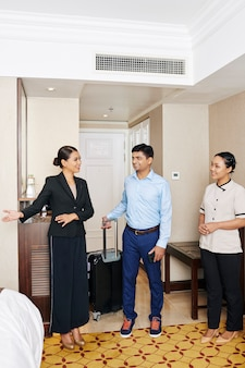 Hotel manager showing the room to guest