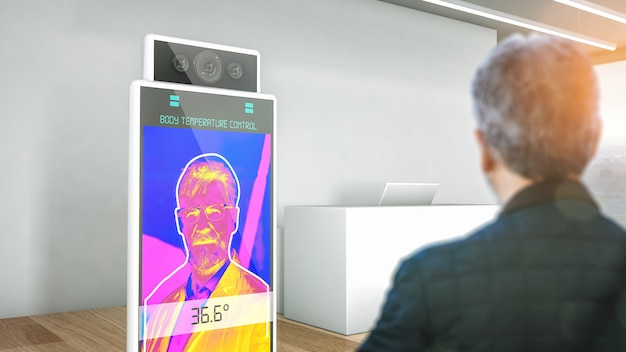 Hotel reception with a body temperature scanning device