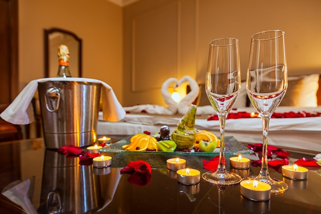 Hotel room for a honeymoon: a table with a fruit plate and candles
