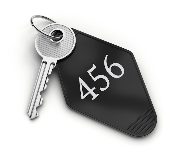 Hotel room key with number isolated on white background.