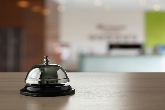 Hotel service bell on wood counter background