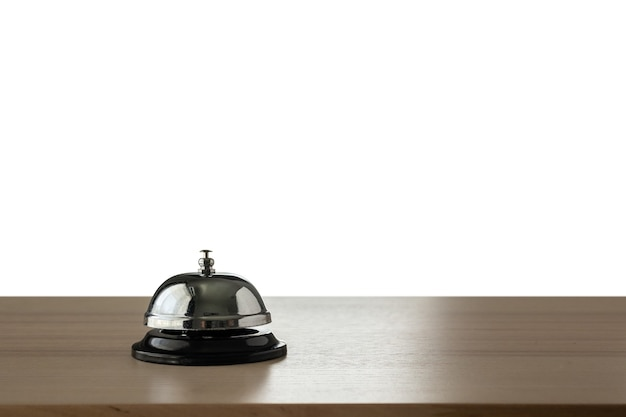 Hotel service bell on wood counter isolated on white background