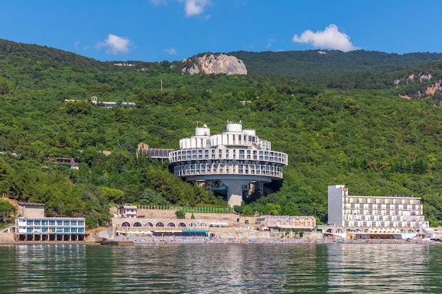 Hotels in crimea on the green forest shore by the black sea.