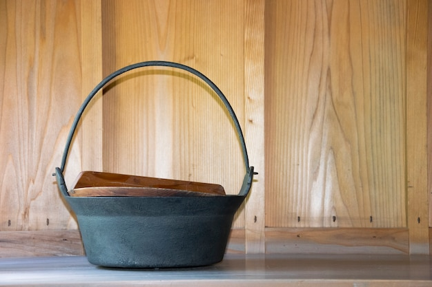 Hotpot with wooden lid in kitchen