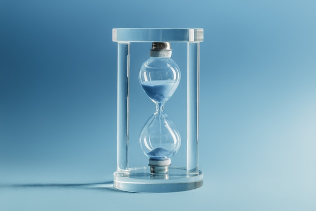 Hourglass on blue