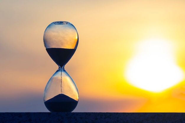 Hourglass counts the length of time against evening sun