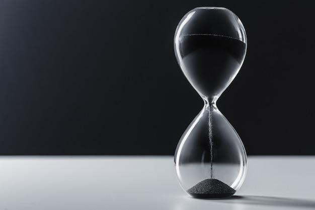Hourglass on dark surface