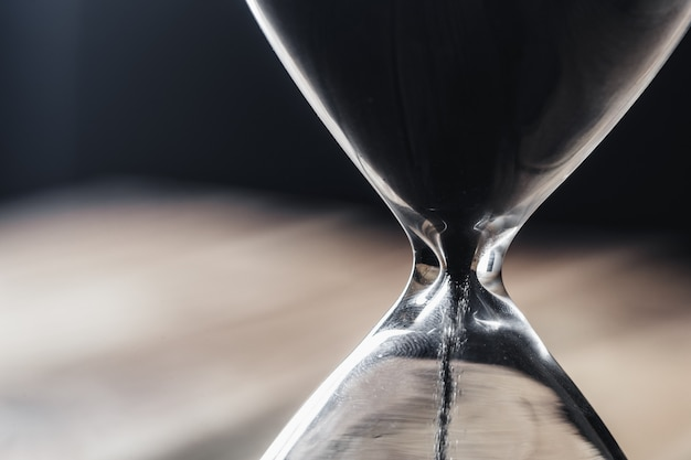 Hourglass on dark