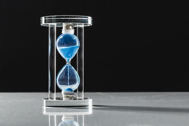 Hourglass on dark