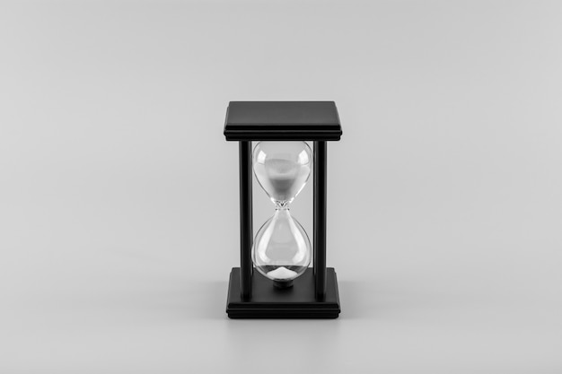 Hourglass on the desk. - monochrome.