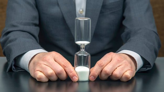 Hourglass in the hand of a business man
