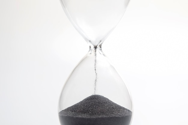 Hourglass on a light background. time is money. business solutions in time.