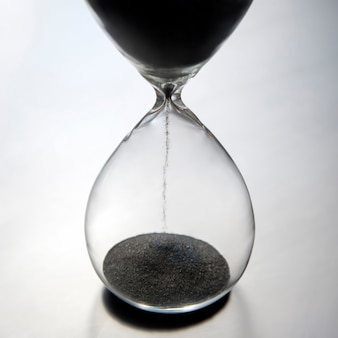Hourglass on a light surface. time is money