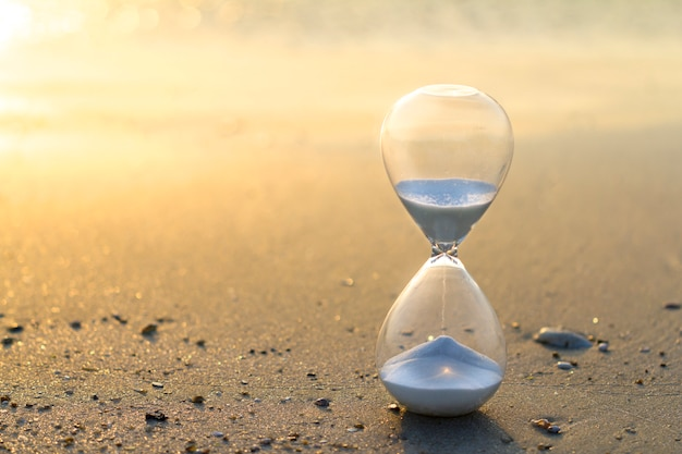 Hourglass, the sand of time in golden light
