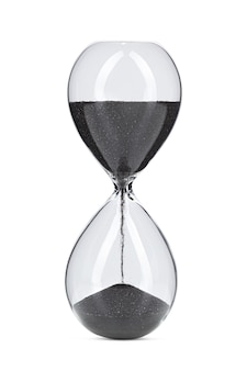 Hourglass with black sand isolated on white background close up