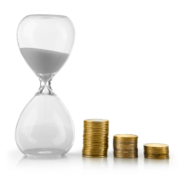 Hourglass with coins on white