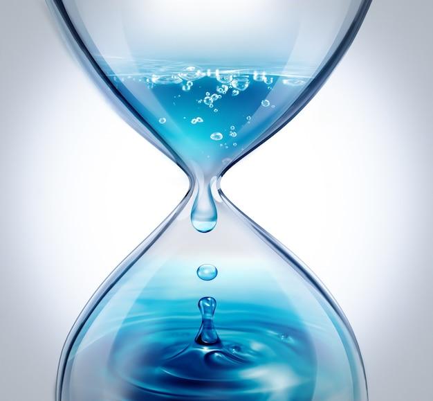 Песочные часы с капающей водой крупным планом на светлом фоне