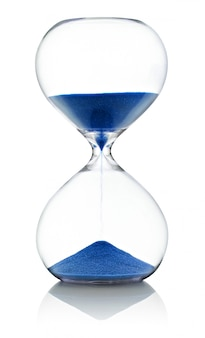 Hourglass with running blue sand over white