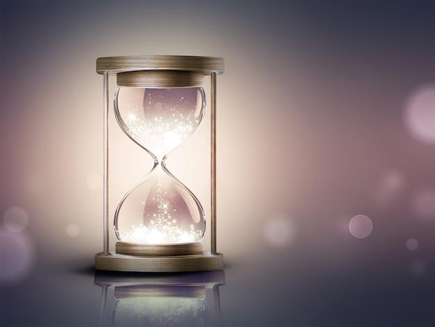 Песочные часы с сияющим светом на темном фоне с эффектом мягкого боке