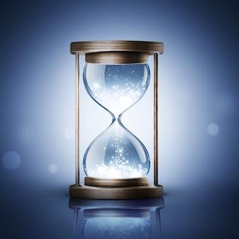 Песочные часы с сияющим светом на синем фоне