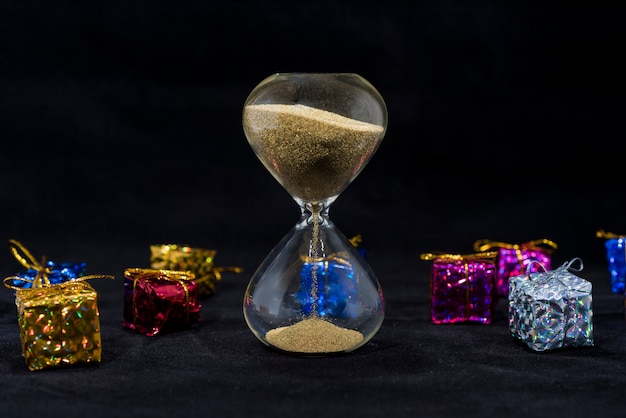Hourglass with small presents