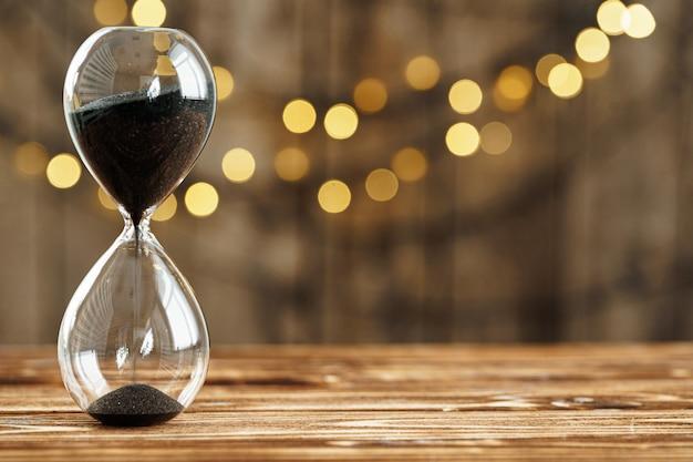 Hourglass on wooden desk