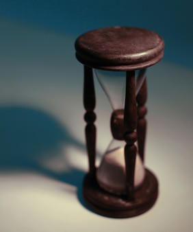 Hourglass on a yellow background.the concept of time.