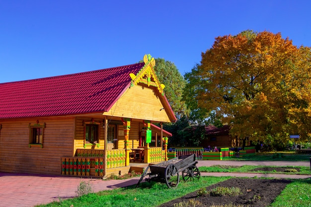 House in autumn park in sunny day Premium Photo