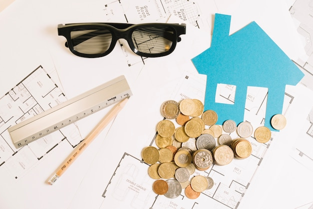 House blueprint and coins flat lay