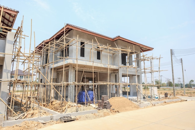 House under construction with autoclaved aerated concrete block structure at building site