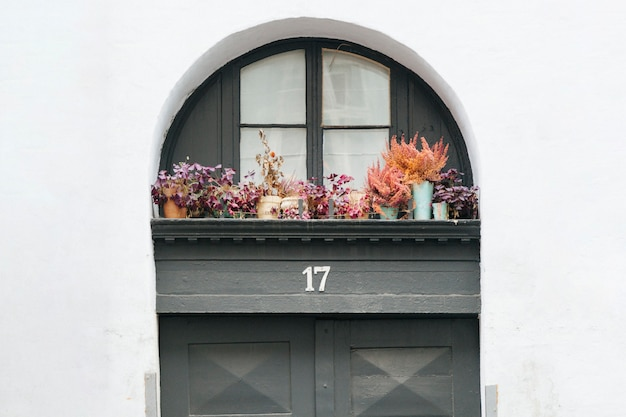 House entrance door with decorated porch