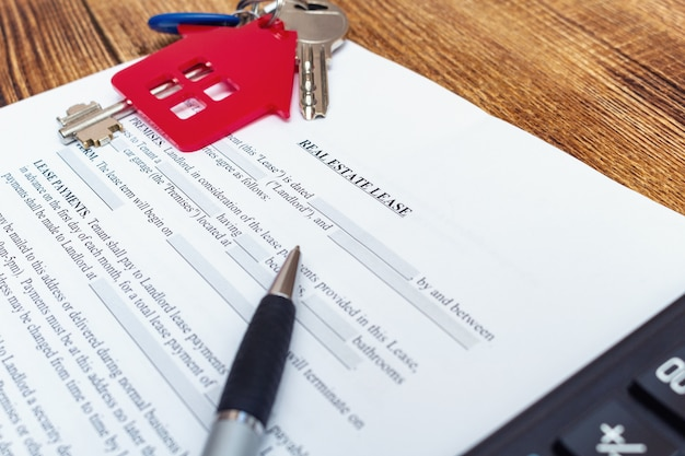 House, home, property, real estate lease, rental contract agreement with pen, keys close up