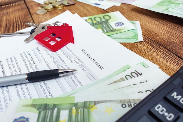 House, home, property, real estate lease rental contract agreement with pen and money