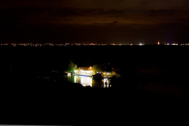 The house is reflected in the water. night landscape