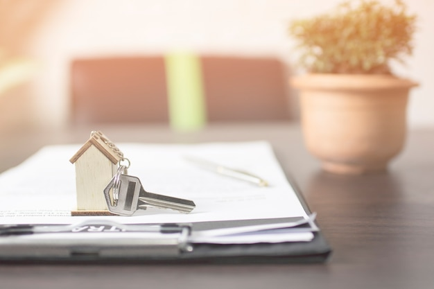 House key on contract paper preparing for owner on table