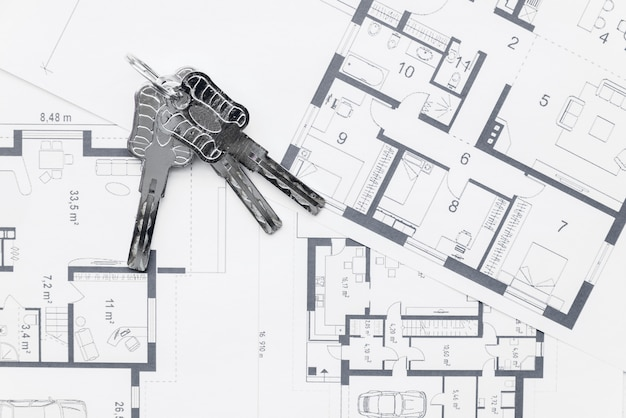 House keys on architectural blueprints plans