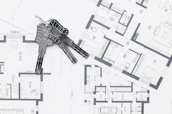 House keys on architectural blueprints plans