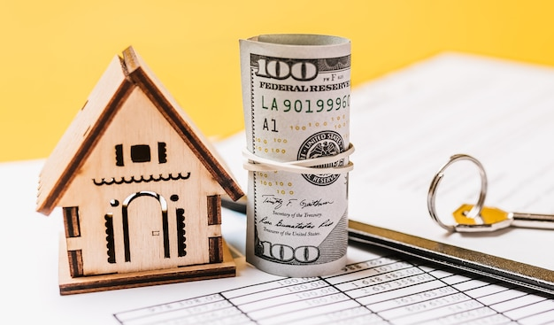 House miniature model and money on documents. investment, real estate, home, housing