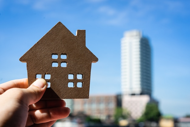 House model in home insurance broker agent's hand or in salesman person.
